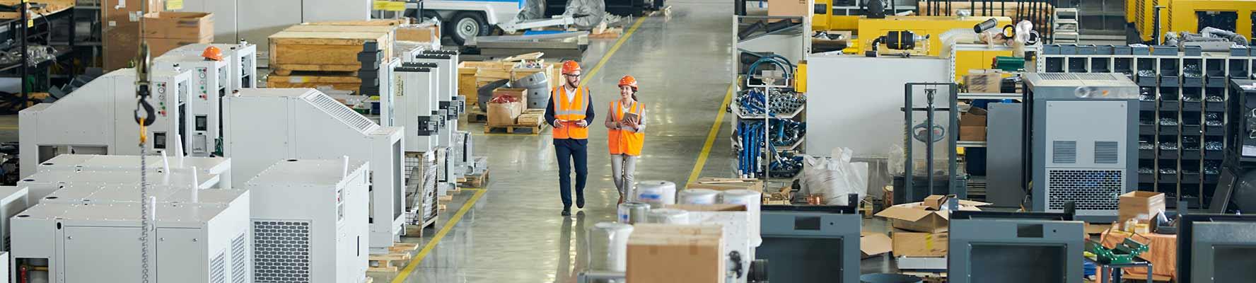 factory floor with two workers walking down corridor